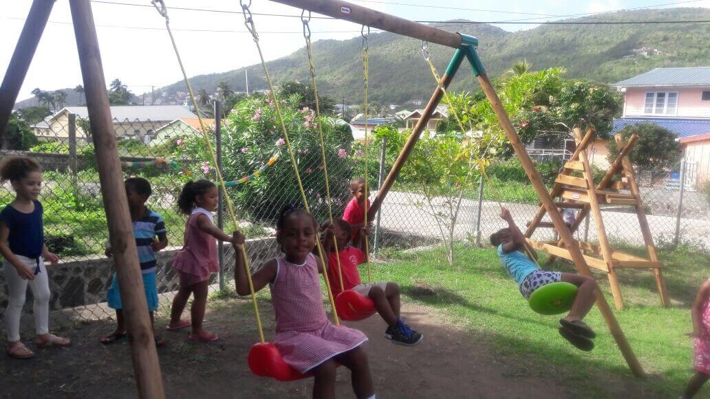 Photograph of children playing on swings