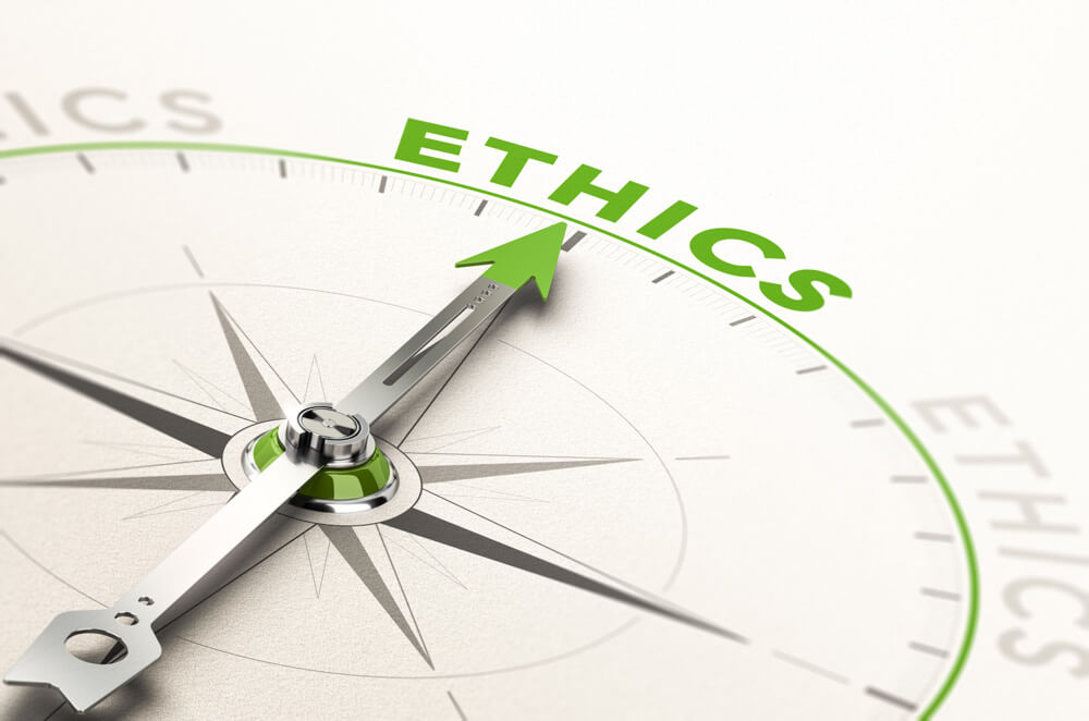 Image of a compass needle pointed towards the word ethics